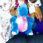 A colorful stuffed dinosaur.