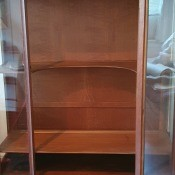 A wooden cabinet with glass doors.