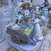 A figurine of a street flower seller.
