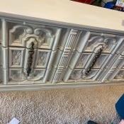 A Bassett dresser with an ornate front.