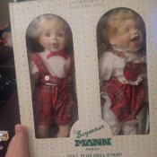 Two porcelain dolls of children on skates.