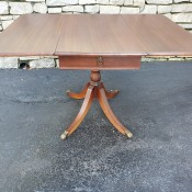 A wooden drop leaf table.