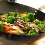 A wok stir frying vegetables.