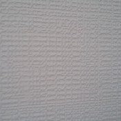 A patterned white wallpaper.