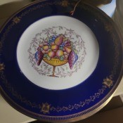 A decorative china plate with a blue rim.
