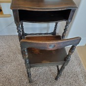 A small wooden desk with matching chair.
