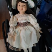 A doll in an old fashioned dress.