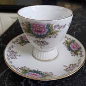 A painted china cup.
