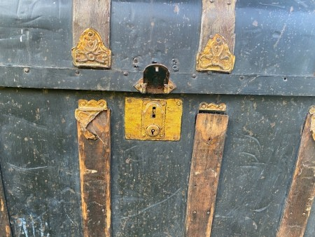 The lock on a steamer trunk.