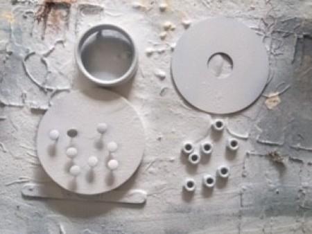 Spray painting old hardware.