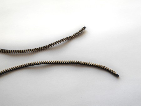 Two pieces of brass zipper.