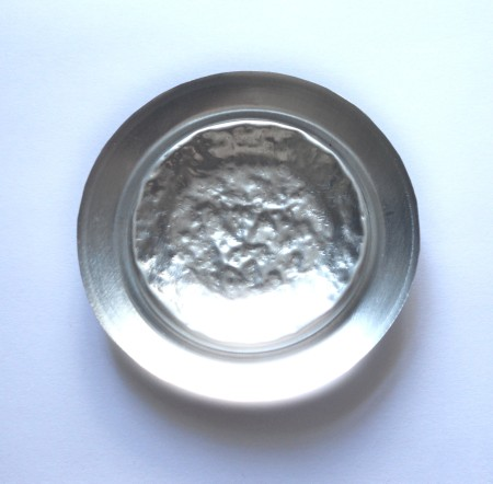 The can bottom with the center rough.