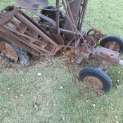A rusted piece of farm equipment.