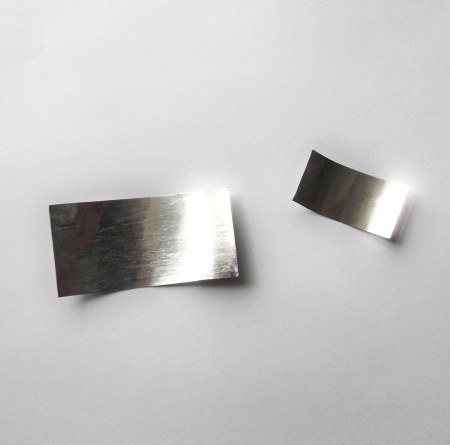Two pieces of aluminum can cut into rectangles.