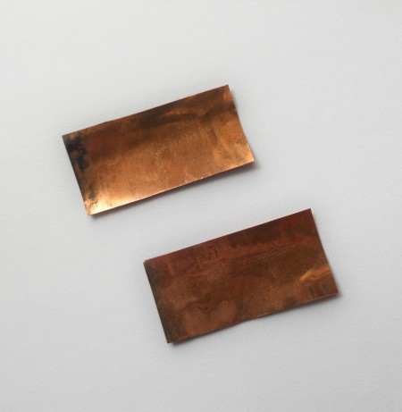 Two pieces of recycled copper foil.