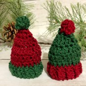 Two crocheted Christmas hats.