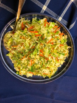 Mixing the cole slaw.