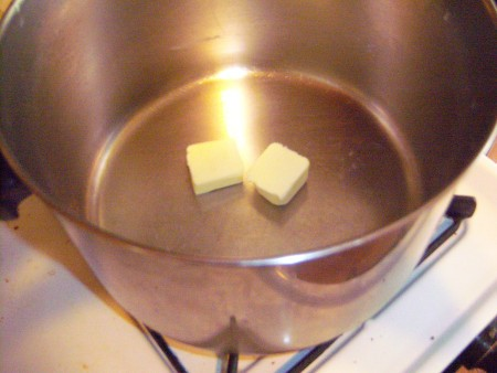 Melting butter in the soup pot.