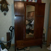 A chifferobe with a mirror.