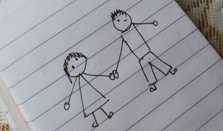 A drawing of two people holding hands.