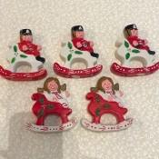 Five Christmas ornaments.