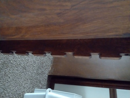The bottom edge of a game table.
