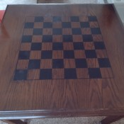 A game table with a checkerboard design on the top.