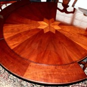 A wooden perimeter leaf table.