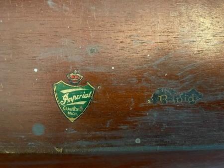 The manufacturer label on a desk.