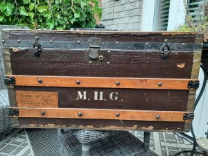 An old trunk with M.H.G. on the front.