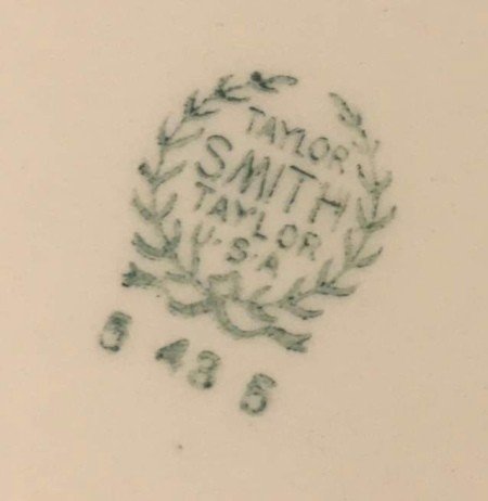 The manufacturer's marking on the back of a plate.