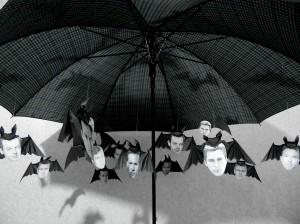 Attaching the bats to an umbrella.