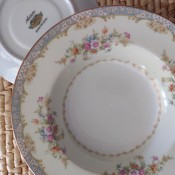A china plate with a floral pattern.