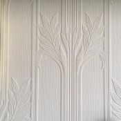 A decorative pattern on white wallpaper.