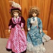 Two decorative porcelain dolls.